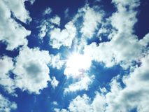 Bright sun in the sky. With cumulus clouds. Closeup Royalty Free Stock Photography
