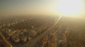 Bright sun and smog over the Turkish city of Konya from a height. KONYA / TURKEY - 11.20.2016 central streets of the ancient Turkish city stock video