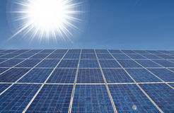 Bright sun with solar panel Stock Photos
