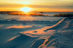 Bright sun  sunset in winter with large snow drifts. Royalty Free Stock Photos