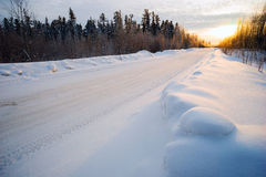Bright sun  sunset in winter snow-covered road . Stock Photo