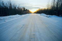 Bright sun  sunset in winter snow-covered road . Royalty Free Stock Photography