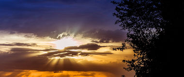 Bright sunlight and through clouds Royalty Free Stock Image