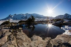 Mountain Scenery in Desolation Wilderness, California. Bright sunlight falls on high mountain scenery in California`s Desolation Wilderness, not far from Lake stock image