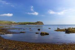 Bright sunlight illuminates sea, rocks and cliffs on Jurassic Co Royalty Free Stock Photo