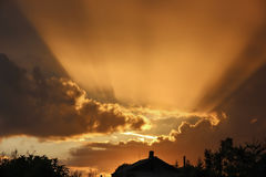 The bright sunlight of the setting sun over the house Royalty Free Stock Photo