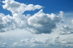 Bright sunny clouds against blue sky Royalty Free Stock Images