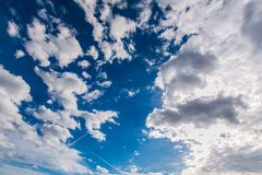 Bright sunny day, dark blue, azure sky with clouds. Bright sunny day, dark blue, azure sky with white cumulus clouds of different shapes, fresh open air, spring royalty free stock photography