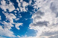 Bright sunny day, dark blue, azure sky with clouds. Bright sunny day, dark blue, azure sky with white cumulus clouds of different shapes, fresh open air, spring stock photo