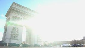 Bright sunny day in Paris, many cars driving by Triumphal Arch, sightseeing tour. Stock footage stock video footage