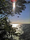 Sunny river. Bright sunny day with sun rays and bright surface of Dnipro river. Ukraine stock photography