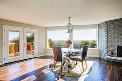 Bright sunny dining room with hardwood floor Royalty Free Stock Photography