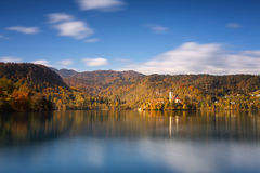 Bright sunny fall day on Lake Bled, Slovenia. Bright sunny fall day on Lake Bled in Slovenia with Mary Church. Long exposure Stock Image