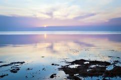 Bright sunny sunrise at the seaside Royalty Free Stock Photo
