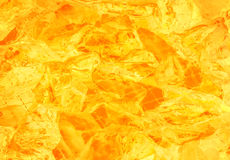 Bright sunny warm ocher background of luminous stones Stock Photo