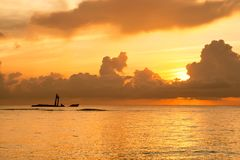 Bright sunrise in early morning with ocean Stock Photography