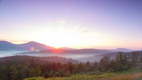 Bright Sunrise and Fog in the Valleys. Time Lapse 4K stock footage
