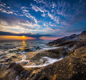 Bright sunrise at the Mediterranean coast in Greece Royalty Free Stock Image
