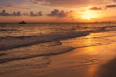 Bright sunrise over Atlantic Ocean. Bavaro beach. Hispaniola Island. Dominican Republic, coastal landscape Stock Images