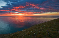 Bright sunrise over the coast of the East Sea. Royalty Free Stock Images