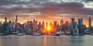 Bright sunrise over Manhattan. Cloudy sunrise over Manhattan, New York Royalty Free Stock Images