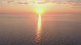 Bright sunrise over the ocean. Rising sun over the sea
