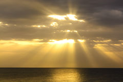 Bright sunrise over the sea in the clouds Royalty Free Stock Photo