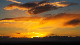 A Bright Sunset Against a Cloudy Sky Stock Images