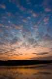 Bright sunset with clouds above the lake Royalty Free Stock Photography
