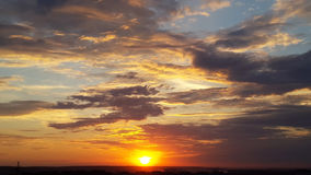Bright sunset and gray clouds. Bright sunset and  gray clouds Royalty Free Stock Photography