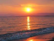 Pink sunset in mediterranean sea Stock Image