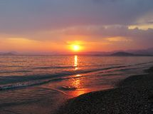 Pink sunset in mediterranean sea Stock Photography
