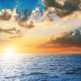 Bright sunset over blue sea Royalty Free Stock Image