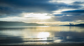 Bright sunset over hills and ocean in Tasmania. Stock Photo