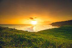 Bright sunset over the ocean and Sumba island. royalty free stock photos