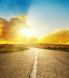 Bright sunset over road Royalty Free Stock Images