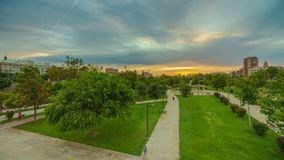 A bright sunset in the park of Turia before the rain. Valencia, Spain.  stock video footage