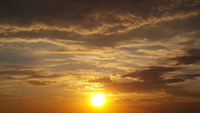 Bright sunset - sun in gray clouds. Bright sunset -  sun in gray clouds Royalty Free Stock Photo