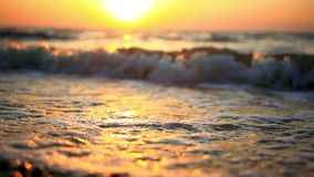 Bright sunset under the sea with waves splashes stock video
