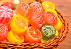 Bright sweets, lollipops, jellies in the basket Stock Photos