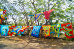Bright Tapestries For Sale. Colorful cloth tapestries for sale as souvenirs at a street market in Costa Rica Royalty Free Stock Photo