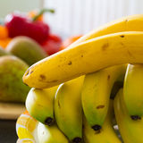 Bright and tasty bananas are on the table Royalty Free Stock Image