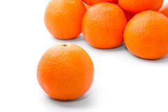 Bright and tasty orange tangerins. Pile isolated on white Royalty Free Stock Photo