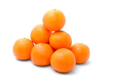 Bright and tasty orange tangerins. Pyramid isolated on white Royalty Free Stock Photo