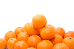 Bright and tasty orange tangerins pile. Isolated on white Royalty Free Stock Photos
