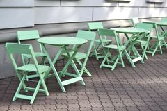 Bright teal coffee shop furniture royalty free stock photo