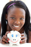 Bright teen girl holding a piggy-bank Stock Photos