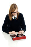 Bright teen student using a tablet device Stock Photo
