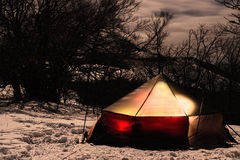 Bright tent in winter mountains at night Stock Photo