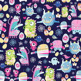 Bright texture of monsters. Colorful seamless pattern of funny monsters on a dark blue background with eggs vector illustration